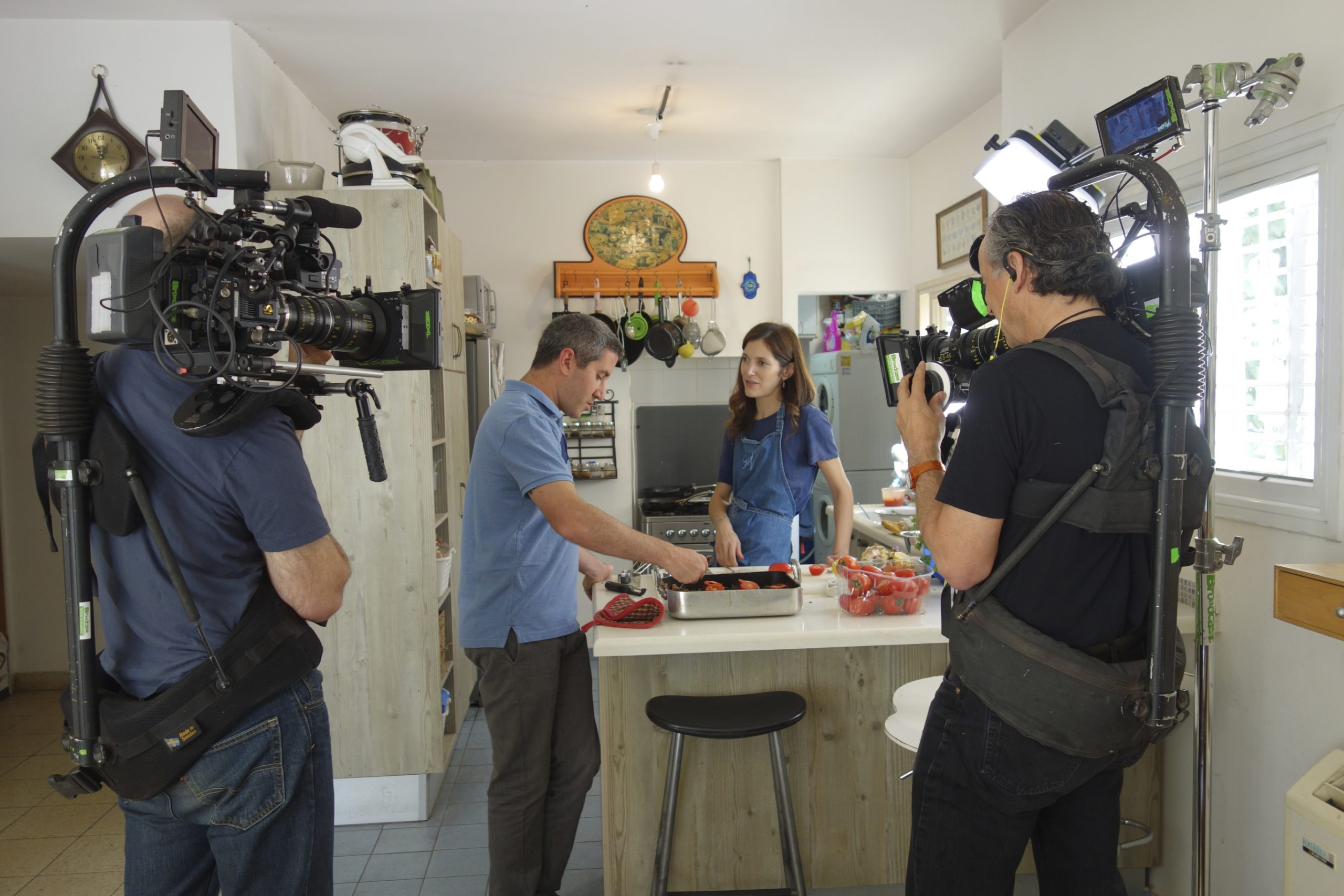 Director/cinematographer Roger Sherman and cinematographer Anthony Savini on location with chef Michael Solomonov and journalist Ruthie Russo in her kitchen in Tel Aviv